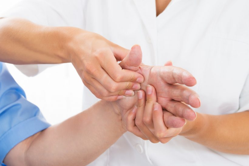 Close-up Of A Person Receiving Palm Massage By Physiotherapist